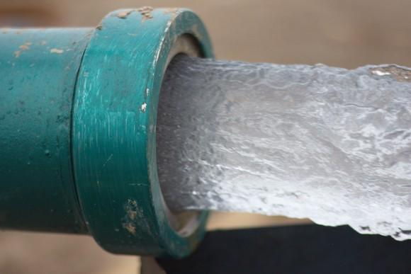 Clean water flowing from a pipe.