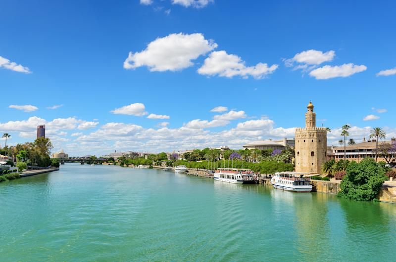 The Guadalquivir River and the Golden Tower, a military lookout spot (syolacan via Getty Images)