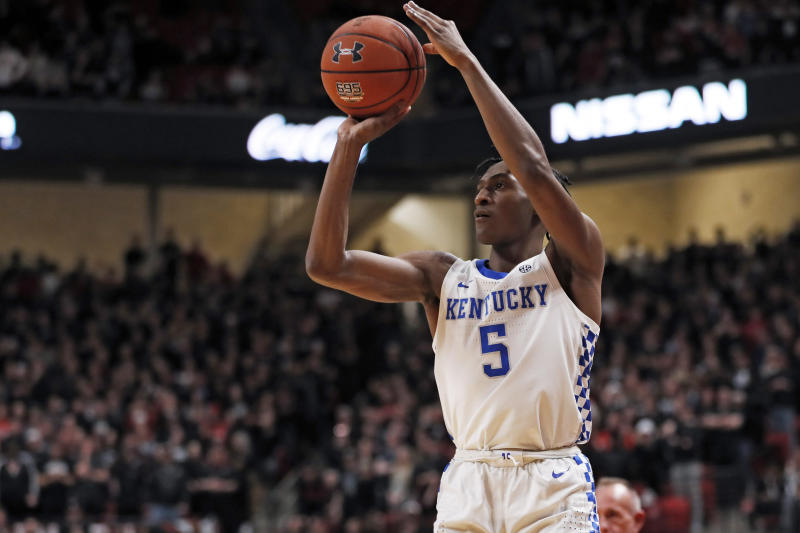 Kentucky's Immanuel Quickley (5) shoots the ball for three points during the first half of an NCAA college basketball game against Texas Tech, Saturday, Jan. 25, 2020, in Lubbock, Texas. (AP Photo/Brad Tollefson)