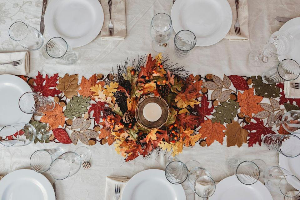 <p>There's nothing quite like a walk on a crisp fall day to enjoy the changing leaves. Bring the same vibe to your home with a faux leaf centerpiece filled with all of autumn's gorgeous hues.</p>