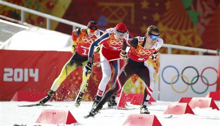 (R to L) Austria's Lukas Klapfer, Norway's Magnus Hovdal Moan and Germany's Eric Frenzel compete during the men's relay 4x5km cross-country race of the Nordic Combined team Gundersen event of the Sochi 2014 Winter Olympic Games, at the RusSki Gorki Ski Jumping Center in Rosa Khutor, February 20, 2014. REUTERS/Stefan Wermuth
