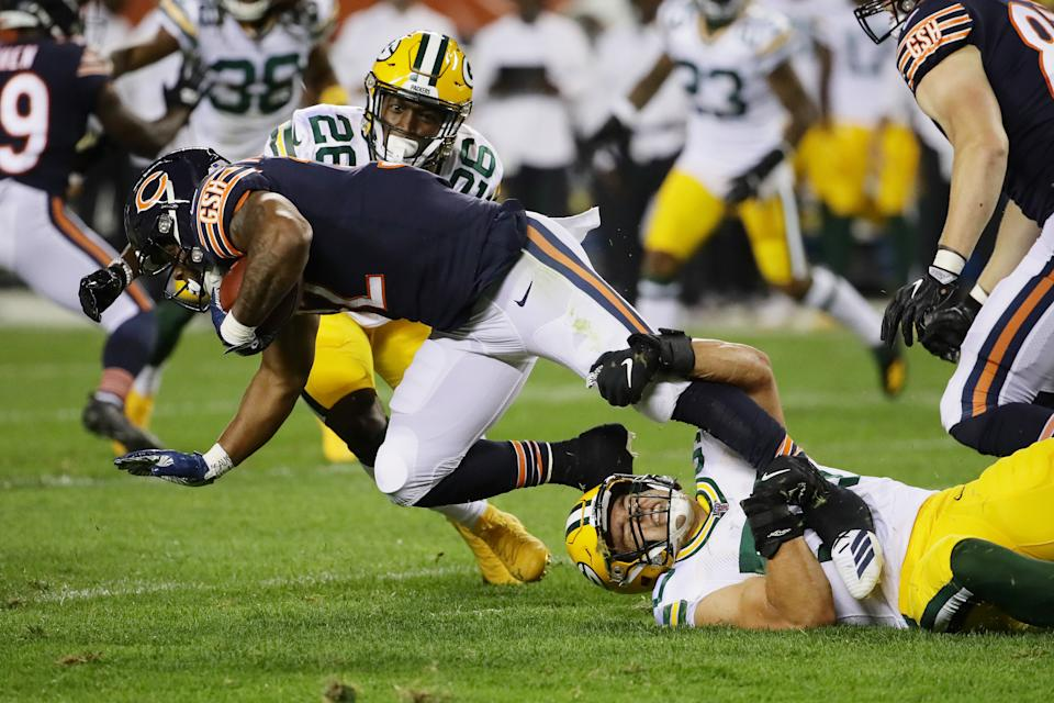 David Montgomery #32 of the Chicago Bears is tackled by Blake Martinez #50 of the Green Bay Packers during the first quarter in the game at Soldier Field on September 05, 2019 in Chicago, Illinois. (Photo by Jonathan Daniel/Getty Images)