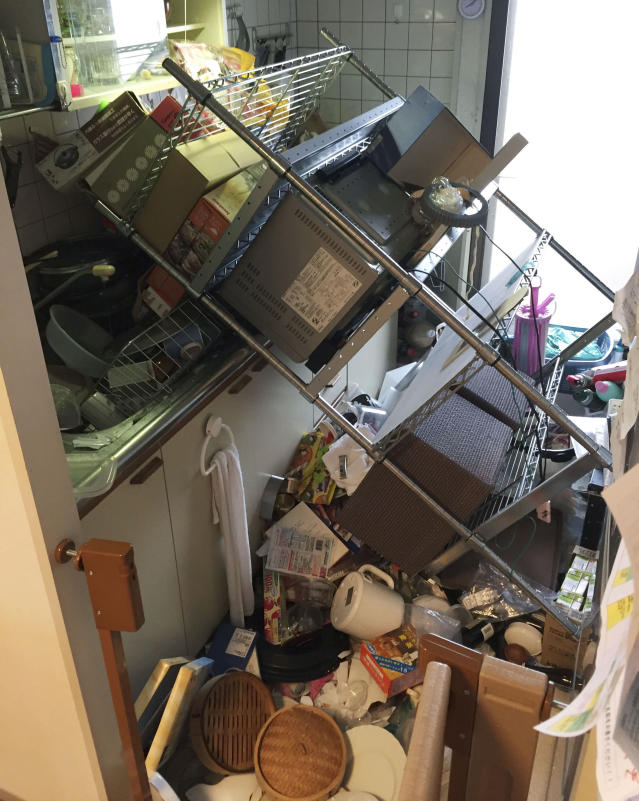 <p>Scattered objects lie in the kitchen of a damaged house in Osaka, following an earthquake Monday, June 18, 2018. A strong earthquake has shaken the city of Osaka in western Japan. There are reports of scattered damage including broken glass and concrete. (Photo: Kyodo News via AP) </p>