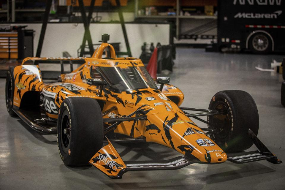 In this photo provided by McLaren Racing, the Arrow McLaren SP IndyCar displays the paint scheme designed by streetwear brand Undefeated at the Arrow McLaren SP team shop in Indianapolis, Tuesday, May 11, 2021. McLaren collaborated with designer James Bond of Undefeated for the car Felix Rosenqvist will drive in the Indianapolis 500. (Chris Zona/McLaren Racing via AP)