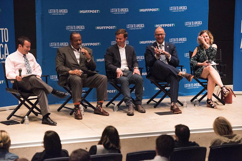 """Moderator Andrew Meyer speaks to panelists Marco Sommerville, Kyle Kutuchief, Jason Segedy and Cheryl Powell during the """"Building a New Vision for Downtown Akron"""" event at the Akron Art Museum."""