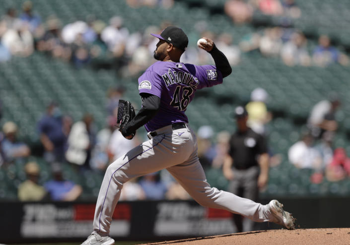 Colorado Rockies starting pitcher German Marquez works agains the Seattle Mariners during the first inning of a baseball game, Wednesday, June 23, 2021, in Seattle. (AP Photo/John Froschauer)
