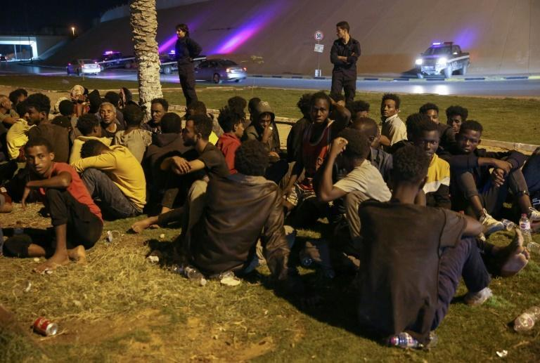 Libyan authorities round up migrants who attempted to join a mass breakout from an overcrowded Tripoli detention centre after guards shot dead six detainees (AFP/Hussam AHMED)