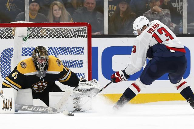 Washington Capitals' Jakub Vrana (13) sets up to score on Boston Bruins' Jaroslav Halak in the shootout of an NHL hockey game in Boston, Saturday, Nov. 16, 2019. (AP Photo/Michael Dwyer)
