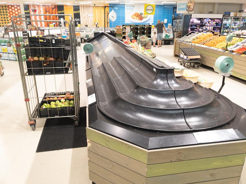 Empty fruit and vegetable shelves in an Australian supermarket after panic buying due to the COVID-19 Coronavirus.-