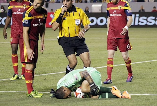 Real Salt Lake goalkeeper Nick Rimando lies on the field in pain after blocking a shot from the Los Angeles Galaxy in the second half of an MLS soccer game in Carson, Calif., Saturday, March 8, 2014. Real Salt Lake won, 1-0. (AP Photo/Reed Saxon)