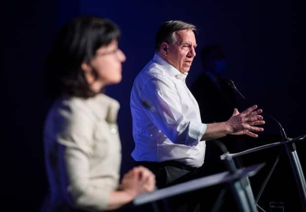Legault and Sonia Lebel, Minister Responsible for Government Administration, speak during a news conference following a meeting with union leaders in Montreal, Sunday.