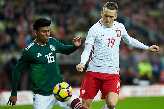 Soccer Football - International Friendly - Poland vs Mexico - Energa Stadium, Gdansk, Poland - November 13, 2017 PolandÕs Piotr Zielinski in action with MexicoÕs Jesus Gallardo Agencja Gazeta/Jan Rusek via REUTERS POLAND OUT. NO COMMERCIAL OR EDITORIAL SALES IN POLAND THIS IMAGE HAS BEEN SUPPLIED BY A THIRD PARTY.