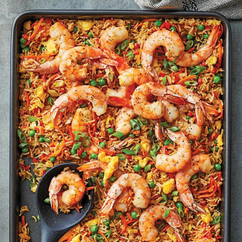 "<p>Classic shrimp fried rice gets amped-up flavor with sambal heat. The textures are pretty spot on with hits of crispy and tender rice and are the same as you'd get if you prepared it in a wok or skillet. This sheet-pan shrimp fried rice recipe is a great way to use leftover rice, but you could also use pre-cooked microwave rice so that it can be coming to room temperature while you chop the veggies. <a href=""http://www.eatingwell.com/recipe/278425/sheet-pan-shrimp-fried-rice/"" rel=""nofollow noopener"" target=""_blank"" data-ylk=""slk:View recipe"" class=""link rapid-noclick-resp""> View recipe </a></p>"