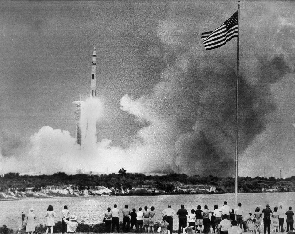 FILE - In this April 11, 1970 file photo, crowds watch the lift-off of the Saturn V rocket carrying the Apollo 13 spacecraft on its mission to the moon from Cape Kennedy, Fla. (AP Photo)
