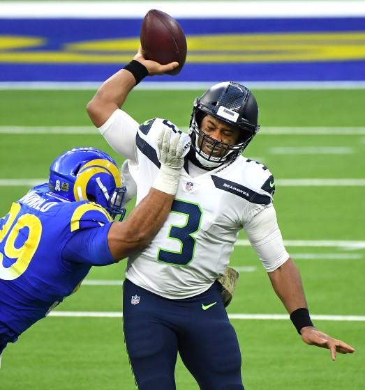 LOS ANGELES, CALIFORNIA NOVEMBER 15, 2020-Rams Aaron Donald forces Seahawks quarterback Russell Wilson into an incomplete pass in the 3rd quarter at SoFi Stadium in Inglewood Sunday. (Wally Skalij/Los Angeles Times)