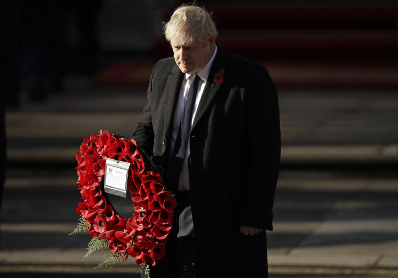 British Prime Minister Boris Johnson prepares to lay a wreath during the Remembrance Sunday ceremony at the Cenotaph in Whitehall in London, Sunday, Nov. 10, 2019. Remembrance Sunday is held each year to commemorate the service men and women who fought in past military conflicts. (AP Photo/Matt Dunham)