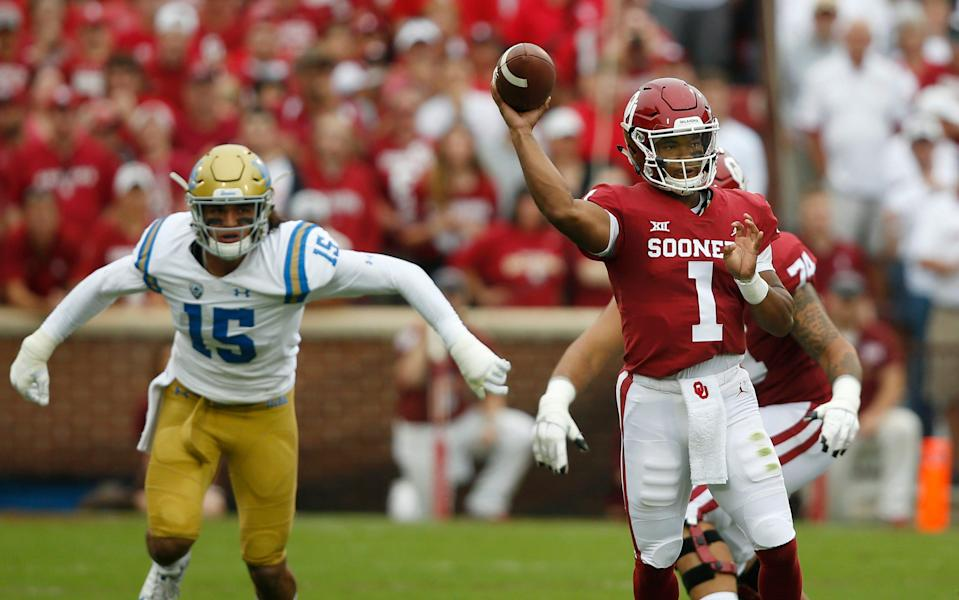 Oklahoma quarterback Kyler Murray (1) throws in front of UCLA linebacker Jaelan Phillips (15) in the first quarter of an NCAA college football game in Norman, Okla., Saturday, Sept. 8, 2018. (AP Photo/Sue Ogrocki)