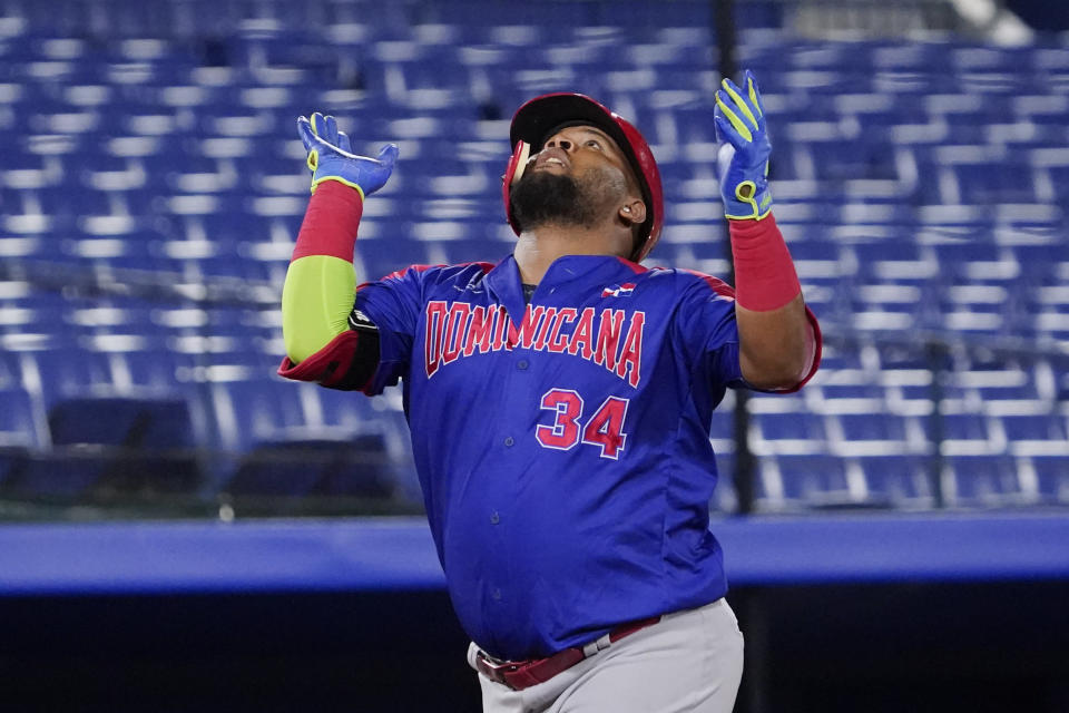 Dominican Republic's Juan Francisco celebrate his home run in the fourth inning of of a baseball game against South Korea at the 2020 Summer Olympics, Sunday, Aug. 1, 2021, in Yokohama, Japan. (AP Photo/Sue Ogrocki)