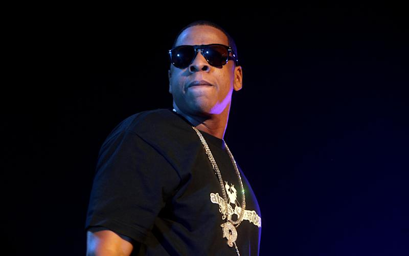 "FILE - In this Nov. 11, 2007, file photo, recording artist Jay-Z performs at Hammerstein Ballroom in New York. Rap artist Jay-Z has said he's been unfairly ""demonized"" because he hasn't backed out of his collaboration with Barneys New York, accused in of racially profiling two black customers. (AP Photo/Gary He, File)"