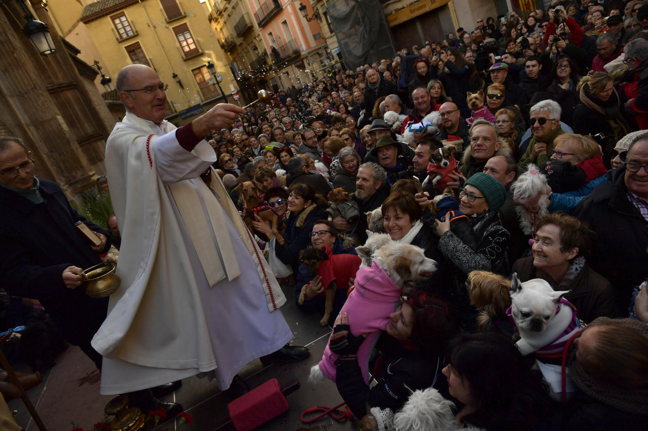 <p>Santiago Fulero, Major priest of the Saint Pablo church, blesses people with their pets outside of the church, during the feast of St. Anthony, Spain's patron saint of animals, in Zaragoza, northern Spain, Wednesday, Jan.17, 2018. (Photo: Alvaro Barrientos/AP) </p>