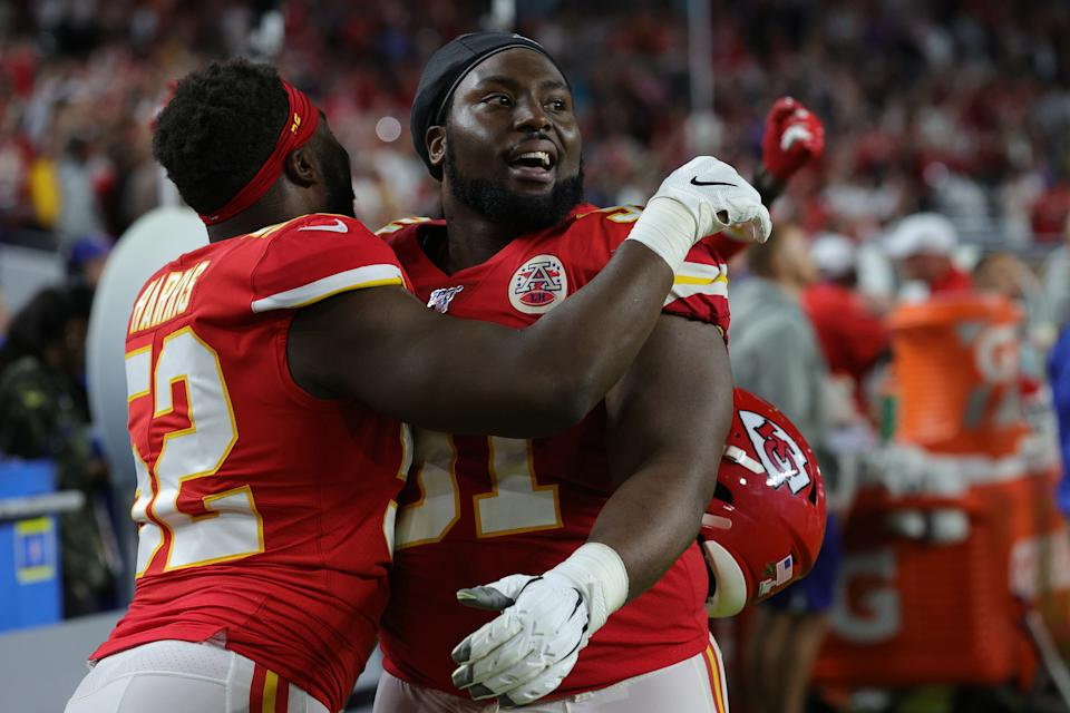 MIAMI, FLORIDA - FEBRUARY 02: Derrick Nnadi #91 of the Kansas City Chiefs celebrates with Demone Harris #52 after they defeated the San Francisco 49ers 31-20 in Super Bowl LIV at Hard Rock Stadium on February 02, 2020 in Miami, Florida. (Photo by Jamie Squire/Getty Images)