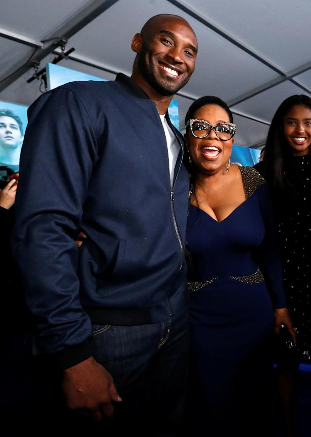 "Cast member Oprah Winfrey and former NBA player Kobe Bryant pose at the premiere of ""A Wrinkle in Time"" in Los Angeles, California, U.S., February 26, 2018. REUTERS/Mario Anzuoni"