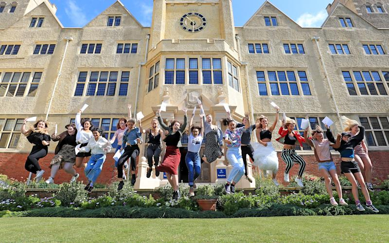 Students celebrate their A Level results from Roedean School in Brighton. (Photo by Gareth Fuller/PA Images via Getty Images)