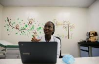 Dr. Marieta Ekeng, a pediatrician at EHA clinics, speaks during an interview with Reuters in her office after teleconsultation with a patient Loveth Metiboba in Abuja