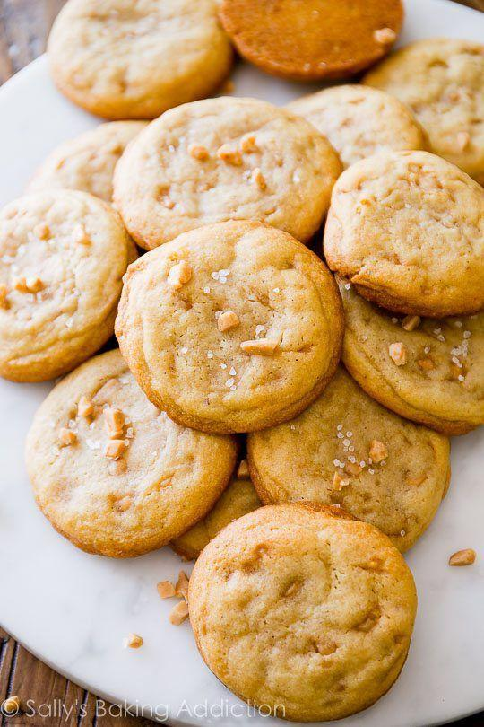 """<p>Nebraska-made butter brickle ice cream is a summertime favorite, but until things thaw out around the state, the residents will be baking batches of butter brickle cookies, studded with melty toffee bits.</p><p>Get the recipe from <a href=""""https://sallysbakingaddiction.com/2015/06/12/salted-vanilla-toffee-cookies/"""" rel=""""nofollow noopener"""" target=""""_blank"""" data-ylk=""""slk:Sally's Baking Addiction"""" class=""""link rapid-noclick-resp"""">Sally's Baking Addiction</a>.</p>"""