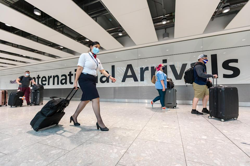 Passengers arrive at Heathrow Airport in London on Tuesday (EPA)