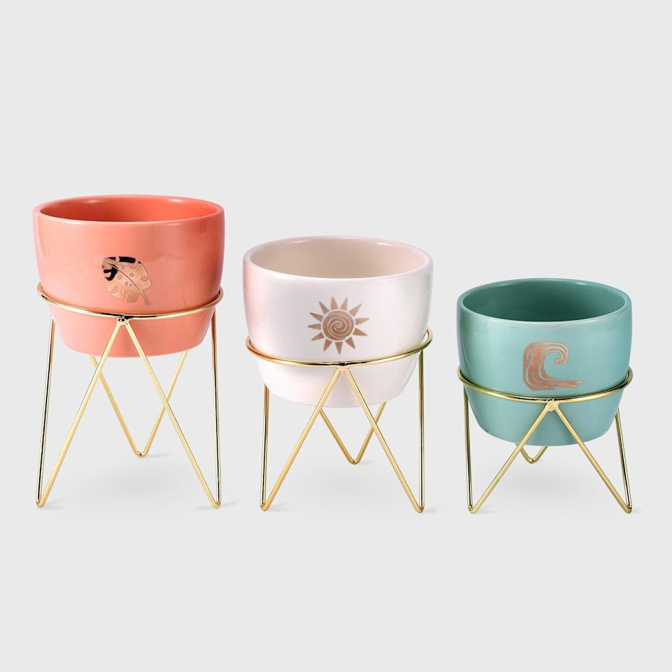 <p>If your loved one has a green thumb, they'll adore the set of three ceramic coral, cream, and mint <span>Disney Princess X POPSUGAR Moana Planters</span> ($20 for three). They are even great for stashing pens and pencils on your desk, jewelry and accessories in the bathroom, and more.</p>