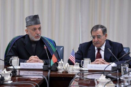"""<p>Afghan President Hamid Karzai (L) speaks during a meeting with Defense Secretary Leon Panetta at the Pentagon on January 10, 2013. Panetta told his """"distinguished visitor"""" that more than 10 years of war had paved the way for Afghanistan to stand on its own.</p>"""