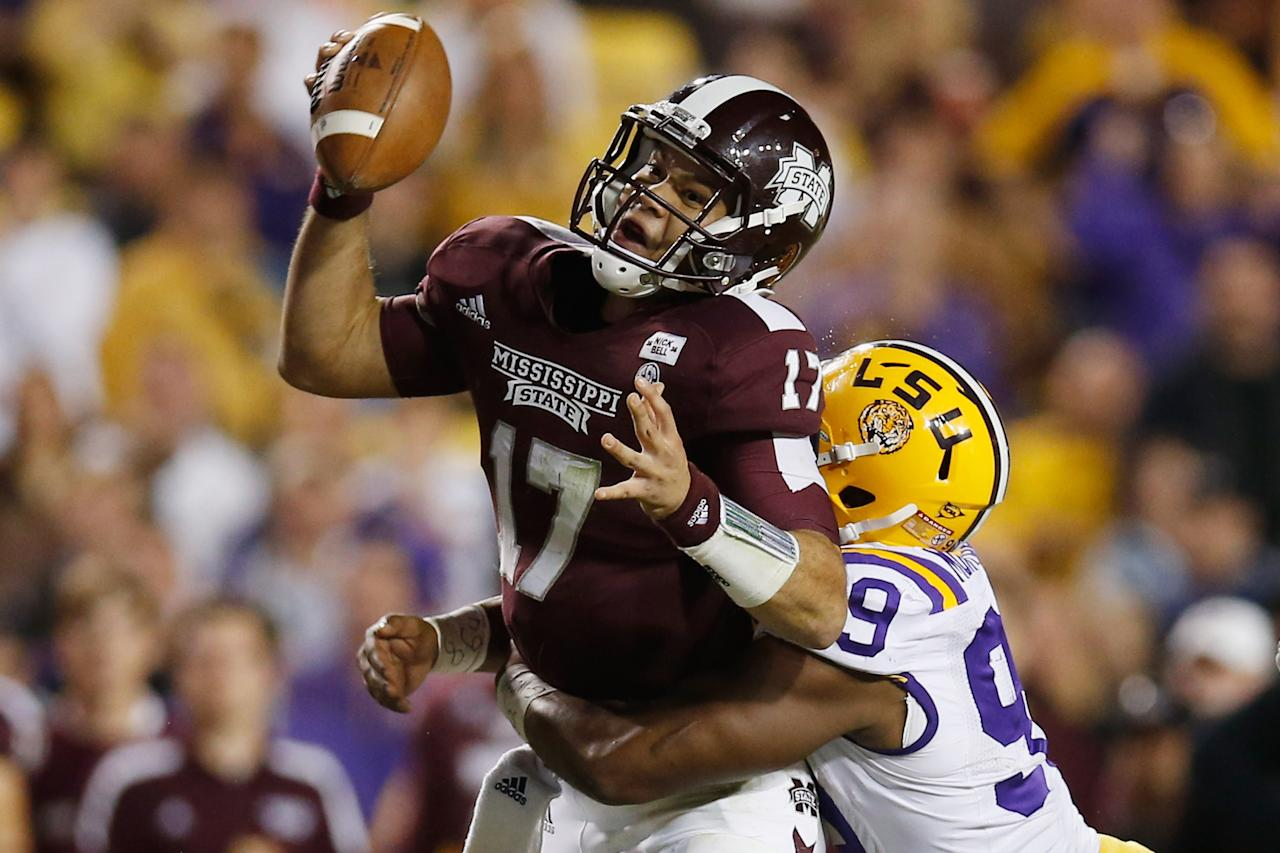 BATON ROUGE, LA - NOVEMBER 10:  Tyler Russell #17 of the Mississippi State Bulldogs is sacked by Sam Montgomery #99 of the LSU Tigers at Tiger Stadium on November 10, 2012 in Baton Rouge, Louisiana.  The Tigers defeated the Bulldogs 37-17.  (Photo by Chris Graythen/Getty Images)