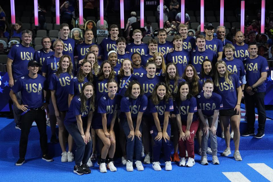 The USA Olympic swim team poses for a picture after the U.S. Olympic Swim Trials on Sunday, June 20, 2021, in Omaha, Neb. (AP Photo/Charlie Neibergall)