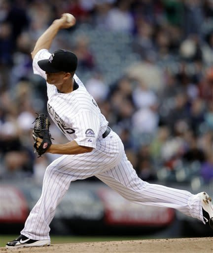 Colorado Rockies starting pitcher Jeremy Guthrie delivers against the San Francisco Giants in the first inning of their baseball game in Denver,Wednesday, April 11, 2012. (AP Photo/Joe Mahoney)