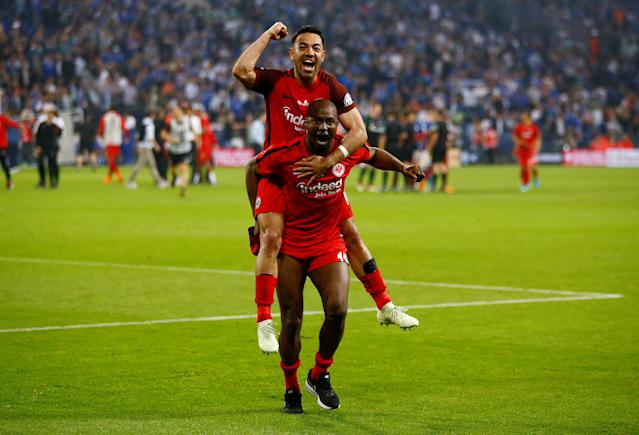 Soccer Football - DFB Cup - Schalke 04 vs Eintracht Frankfurt - Veltins-Arena, Gelsenkirchen, Germany - April 18, 2018 Eintracht Frankfurt's Marco Fabian and Jetro Willems celebrate after reaching the final REUTERS/Wolfgang Rattay DFB RULES PROHIBIT USE IN MMS SERVICES VIA HANDHELD DEVICES UNTIL TWO HOURS AFTER A MATCH AND ANY USAGE ON INTERNET OR ONLINE MEDIA SIMULATING VIDEO FOOTAGE DURING THE MATCH.