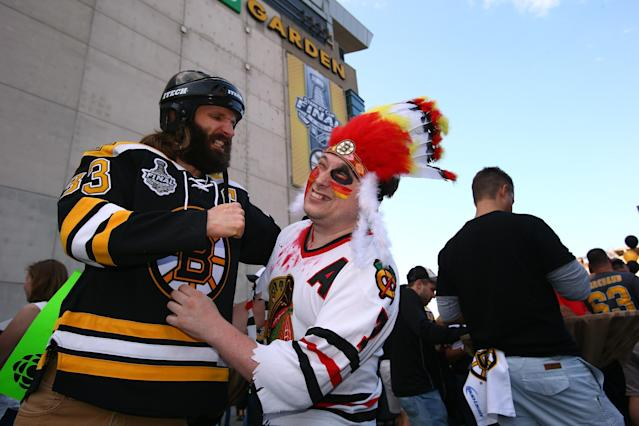 BOSTON, MA - JUNE 19: A fan of the Boston Bruins pretneds to punch a fan of the Chicago Blackhawks prior to Game Four of the 2013 NHL Stanley Cup Final at TD Garden on June 19, 2013 in Boston, Massachusetts. (Photo by Bruce Bennett/Getty Images)