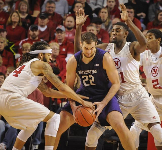 Nebraska's Terran Petteway (44) knocks the ball away from Northwestern center Alex Olah (22) during an NCAA college basketball game Saturday, March 1, 2014, in Lincoln, Neb. (AP Photo/Dave Weaver)