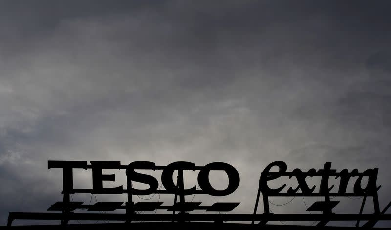 FILE PHOTO: Signage is seen outside a Tesco extra superstore near Manchester