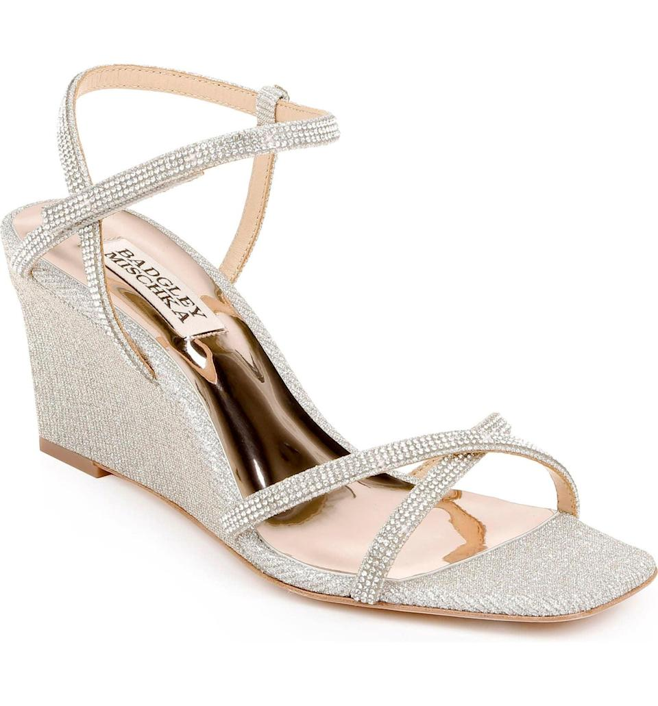 <p>If you are going to a nicer event, this <span>Badgley Mischka Reagan Embellished Wedge</span> ($185) is a good idea. When in doubt, go with something sparkly.</p>