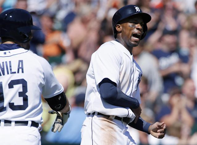 Detroit Tigers' Austin Jackson, right, celebrates with Alex Avila after scoring from second base on a single by Nick Castellanos to take a 2-1 lead over the Los Angeles Angels in the sixth inning of a baseball game Sunday, April 20, 2014, in Detroit. (AP Photo/Duane Burleson)