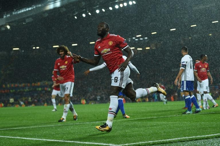 Manchester United's Romelu Lukaku celebrates scoring his team's second goal during their UEFA Champions League Group A match against Basel, at Old Trafford in Manchester, on September 12, 2017