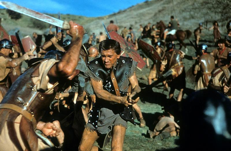 Kirk Douglas the slave Spartacus, engaged in battle in a scene from the film 'Spartacus', 1960. (Photo by Universal Pictures/Getty Images)