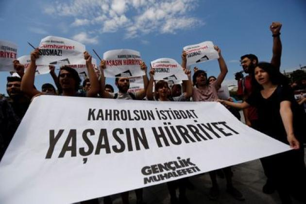 Turkish court remands four opposition newspaper staff in custody, releases seven