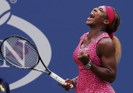 Serena Williams of the U.S. celebrates a point against compatriot Varvara Lepchenko during their match at the 2014 U.S. Open tennis tournament in New York