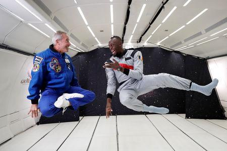 Retired sprinter Usain Bolt and French astronaut Jean-Francois Clervoy, CEO of Novespace, enjoy zero gravity conditions during a flight in a specially modified plane above Reims, France, September 12, 2018. REUTERS/Benoit Tessier