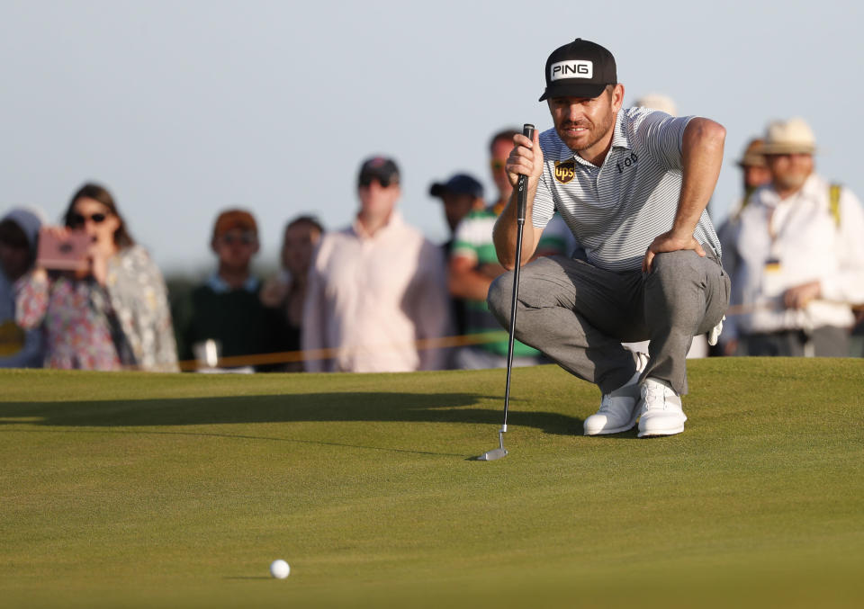 South Africa's Louis Oosthuizen looks at the line of his putt on the 17th green during the third round of the British Open Golf Championship at Royal St George's golf course Sandwich, England, Saturday, July 17, 2021. (AP Photo/Peter Morrison)