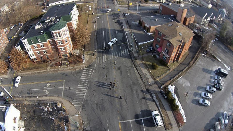 This Feb. 1, 2014 photo, taken by a camera mounted on a drone aircraft and provided by Pedro Rivera, shows an auto that crashed into a building in Hartford, Conn. Rivera filed a federal lawsuit Tuesday, Feb. 18, 2014, alleging that Hartford police officers violated his rights by demanding he stop using the aircraft to record images of the wreck. (AP Photo/Pedro Rivera)