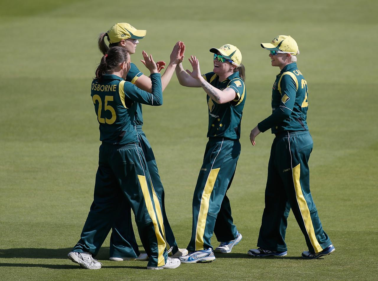 LONDON, ENGLAND - AUGUST 20:  Sarah Coyte of Australia (2R) celebrates with team mates after catching Arran Brindle of England (not pictured) during the first NatWest One Day International match between England and Australia at Lord's Cricket Ground on August 20, 2013 in London, England.  (Photo by Harry Engels/Getty Images)