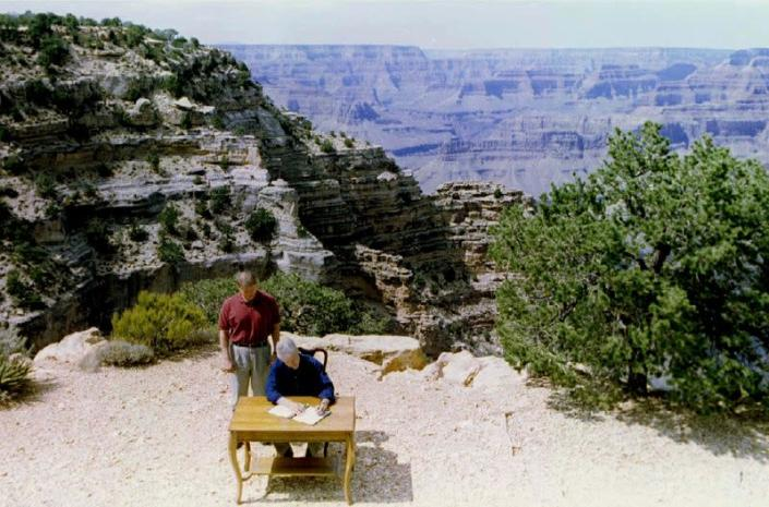 FILE PHOTO: President Clinton (seated) signs into law the creation of the Grand Staircase-Escalante National Mon..